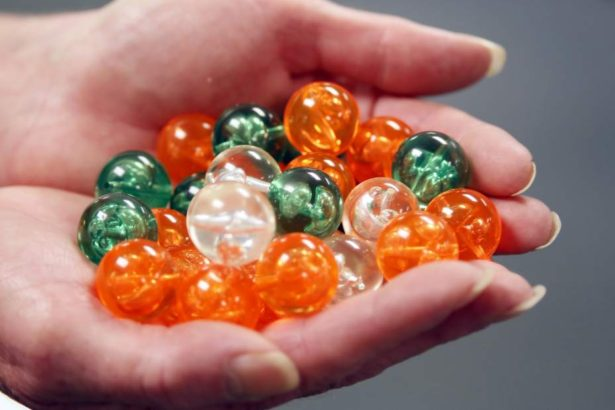 The Beadery, in Hope Valley, owned by Toner Plastics, is producing over 350,000 round acrylic beads for a large art installation called 360 degree Vanishing Point in Houston TX. Barbara Gordon, the sales and marketing manager holds some of the beads that are being shipped to Texas.